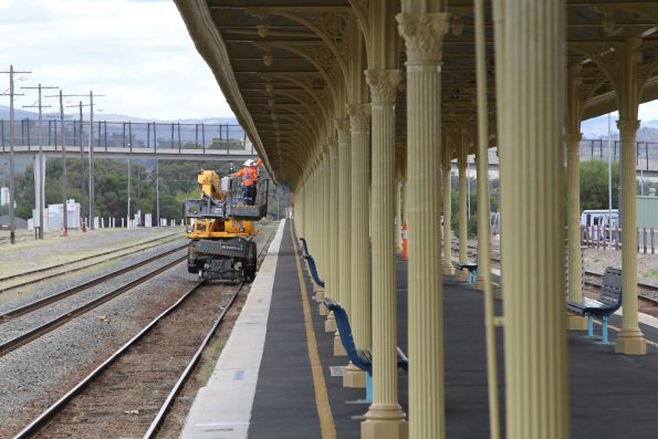 Painting work underway at Albury station, using a hi-rail boom lift