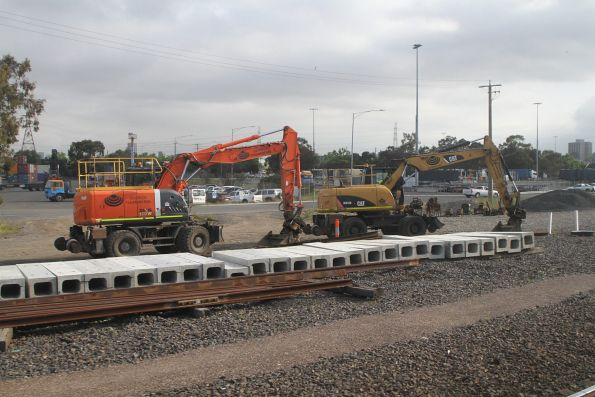 Hi-rail excavators between jobs at Dock Link Road at Dynon