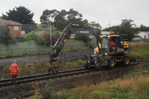 ARTC hi-rail excavator tamping the ballast on the standard gauge at Sunshine