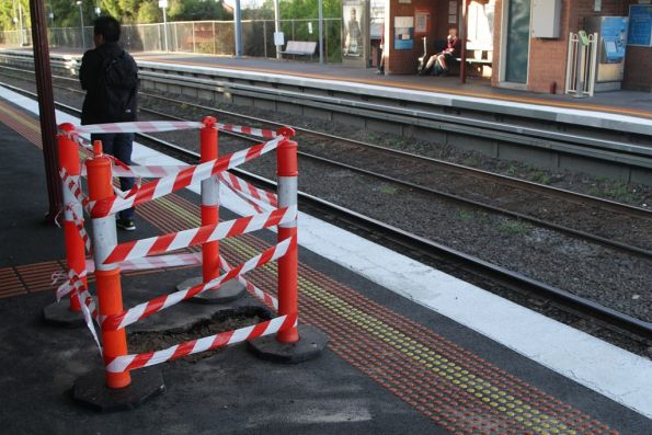 Hole in the platform at Ascot Vale after a burst water main
