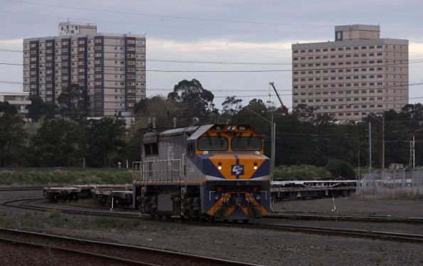 VL356 passes stabled container flats at North Dynon