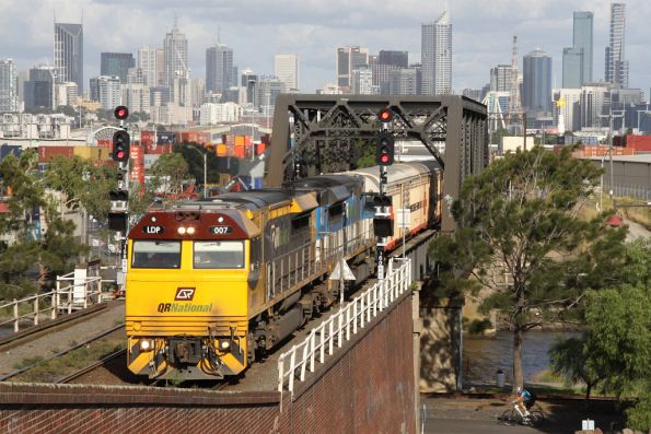 QR National liveried LDP007 leads an EDI liveried classmate on MB7 over the Maribyrnong River at Bunbury Street