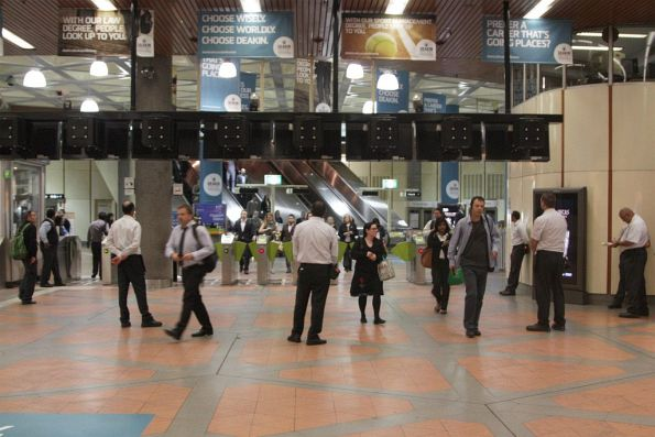 Authorised Officers watching inbound passengers at Flagstaff station in evening peak