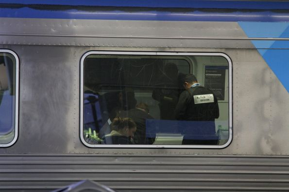 Authorised Officers check tickets onboard a suburban train