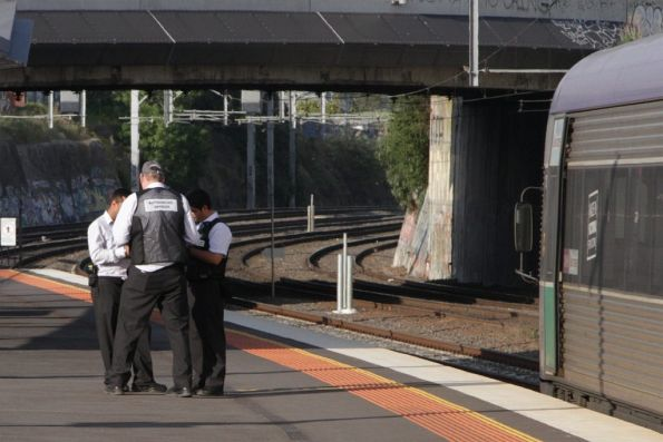 Authorised officers regroup at Footscray, after checking tickets on a citybound V/Line service