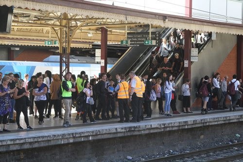 Authorised Officers on crowd control duty at an overcrowded Flinders Street Station platform 4 and 5
