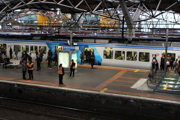 Authorised officers on crowd control duty at Southern Cross platform 10