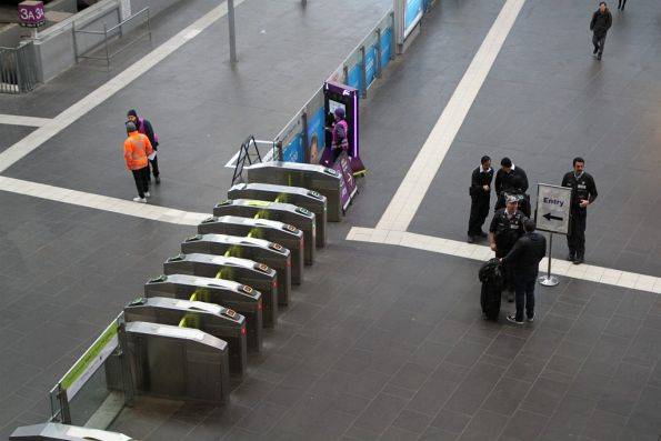 Authorised offices checking tickets at the Southern Cross Station country platforms