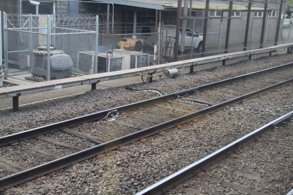 Lincoln automatic rail lubricator in place on the Upfield line tracks at North Melbourne Junction