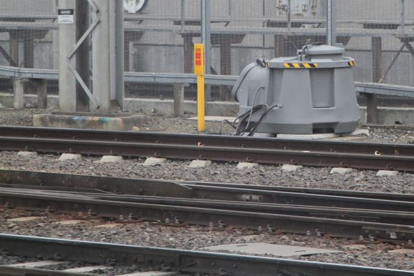 Lincoln automatic rail lubricator at the entrance to Southern Cross Station