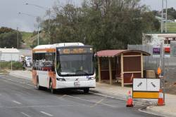 PTV liveried Bacchus Marsh Coaches bus 7025AO on route 433 at Bacchus Marsh station
