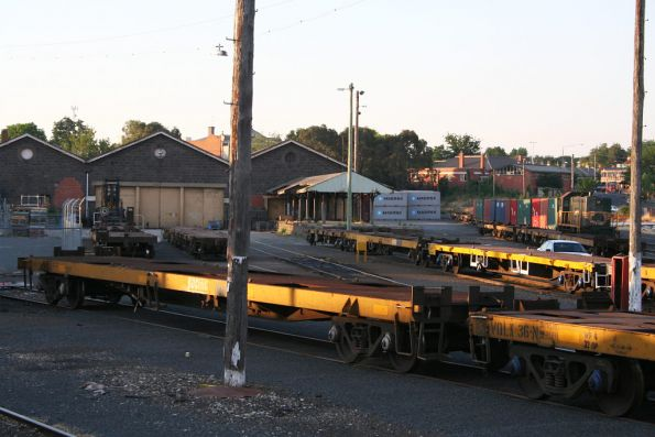 Y119 stabled on a rake of loaded container flats, along with a lot of empty wagons