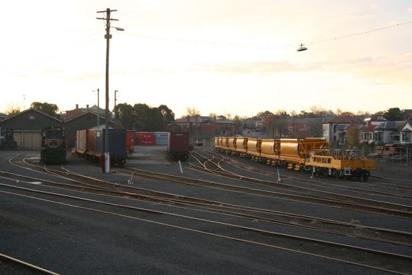 Y119 stabled at Ballarat with container wagons, a ballast train alongside