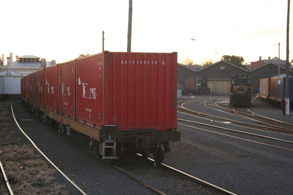 Y119 stabled at Ballarat, loaded container wagons either side