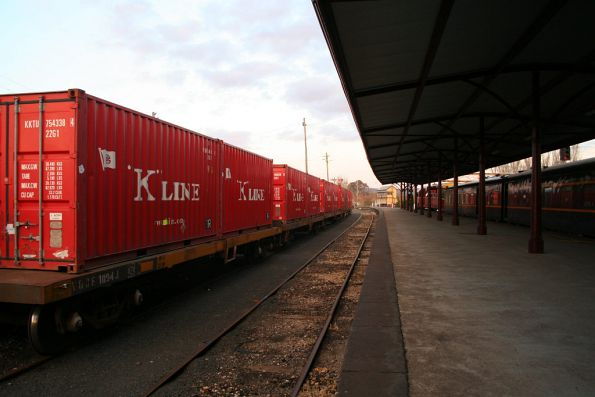 Loaded container wagons waiting for the Mildura freight to pass through