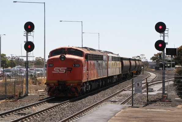 S302 and S317 trail out of Melton station on the down