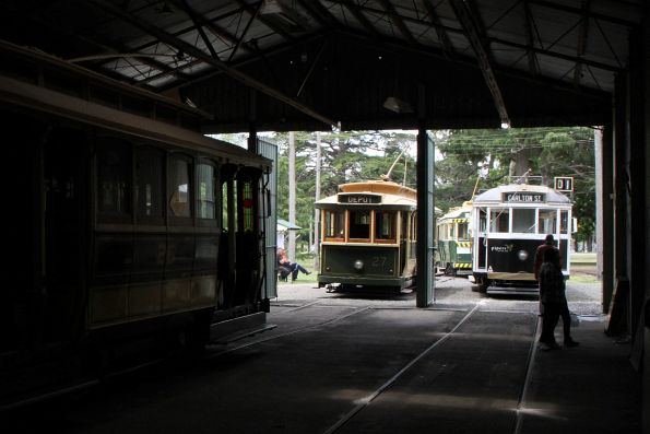 Trams 27 and W4.671 parked outside the shed