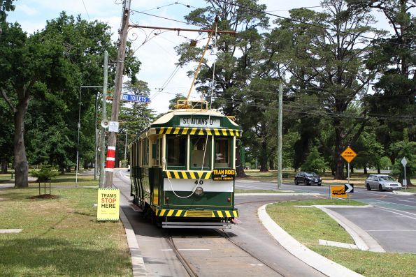 Tram 40 continues past the depot junction