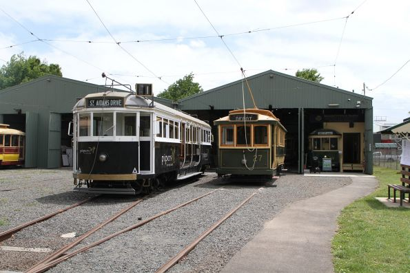 Trams 27 and W4.671 parked outside the depot shed