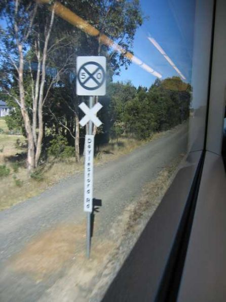 New style of level crossing sign - the crossing ahead is predictor equipped, but trains moving above 50 km/h can increase speed