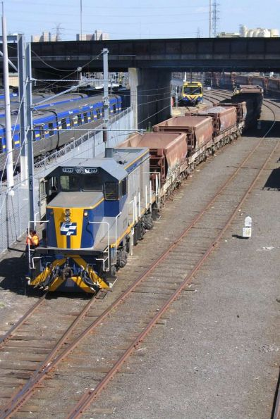 T377 leaves Melbourne Yard with a short ballast train, another rake of ballast hoppers stabled behind