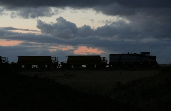 Silhouette of T369 and ballast wagons at Deer Park