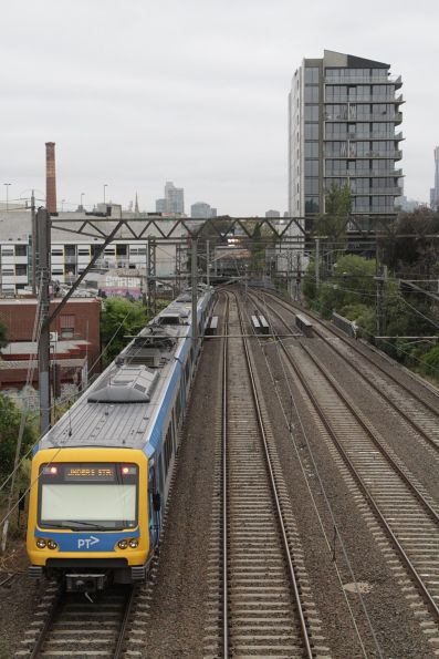 X'Trapolis train approaches South Yarra on the twice-daily Frankston line pork barrel express