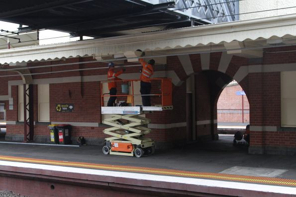 Retrofitting fluorescent lighting beneath the platform veranda at Toorak