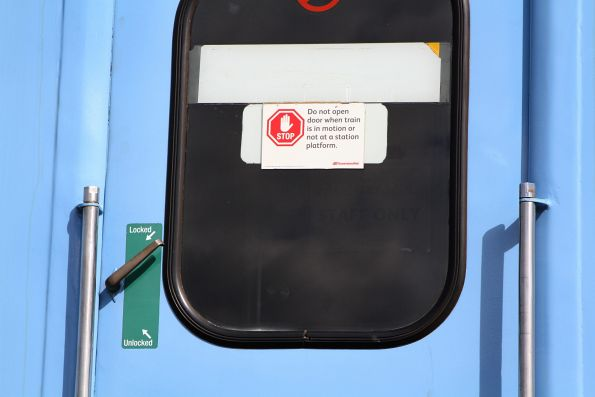 Queensland Rail stickers still in place on the doors of a Q Train carriage