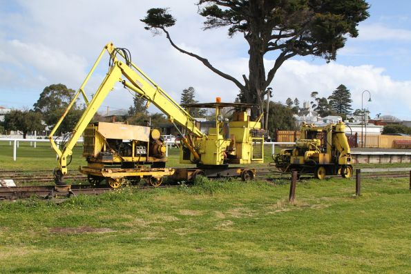 Tie crane and ballast tamper in the yard at Queenscliff