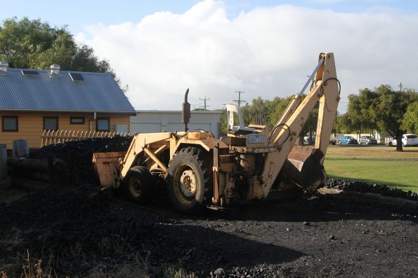 Backhoe loader for loading coal into locomotives at Queenscliff station