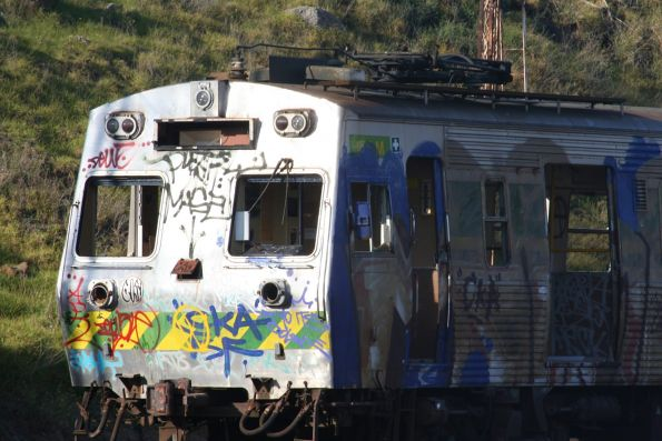 Graffiti covered Hitachi carriages ex-Bendigo on arrival at Newport Workshops