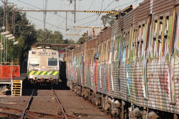 Elecrail Hitachi stabled in the Garden Platform, the graffitied carriages ex-Bendigo in the other road
