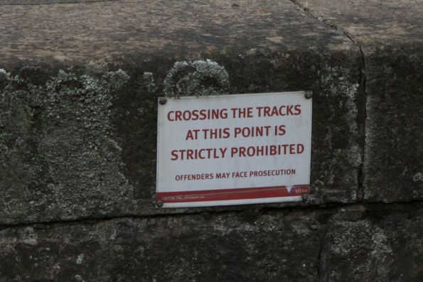 V/Line 'crossing the tracks at this point is strictly prohibited' notice on a platform face