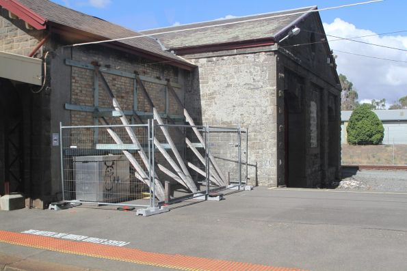 Timber supports prop up the goods shed at Kyneton station