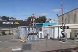 Spare level crossing boom gates decorated in tinsel at Bendigo