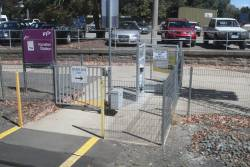 Pedestrian crossing at Kyneton station, with electromagnetic latch on the emergency exit