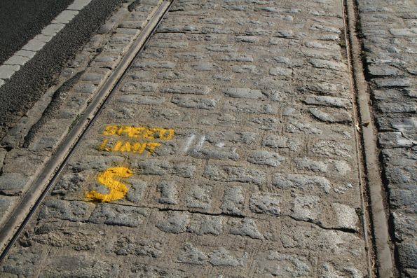 'Speed limit 5 km/h' painted on the tracks along Pall Mall