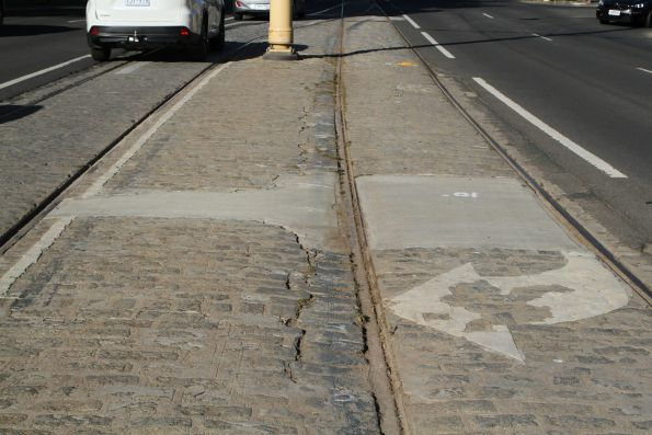 Concrete patch job between the cobblestone track along Pall Mall