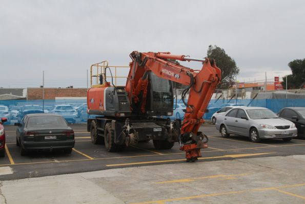 Hi-rail excavator parked in the Blackburn station temporary replacement car park
