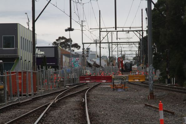 With the railway line closed, work continues on the Blackburn Road level crossing