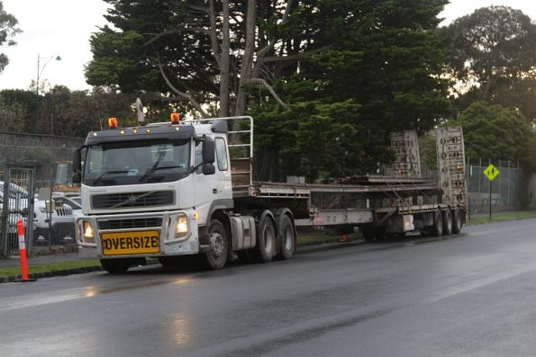Semi trailer loaded with fresh lengths of rail near the Blackburn Road level crossing
