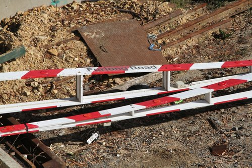 'Furlong Road' level crossing boom gate in the compound at Blackburn