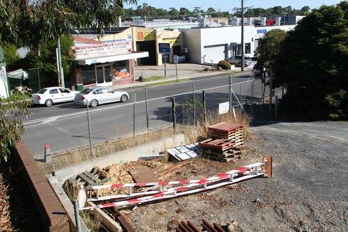 Surplus level crossing boom gates in the compound at Blackburn