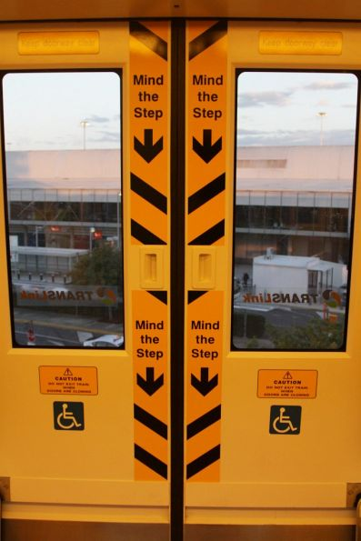 'Mind the step' notices on the doors of a 160-series IMU