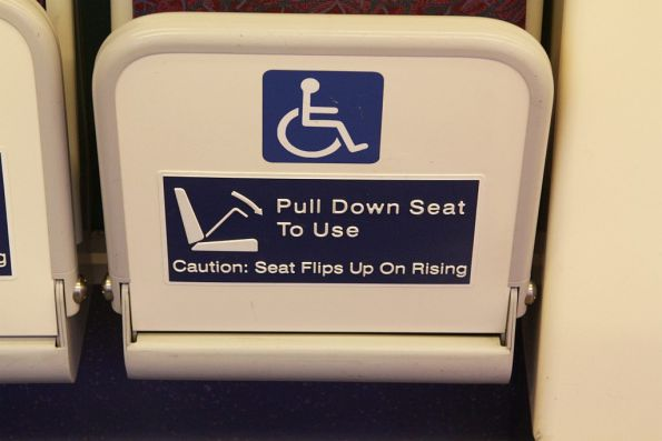'Pull down seat' notice onboard a 160-series IMU