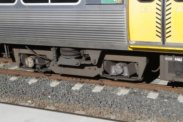 Bogies beneath a Queensland Rail EMU