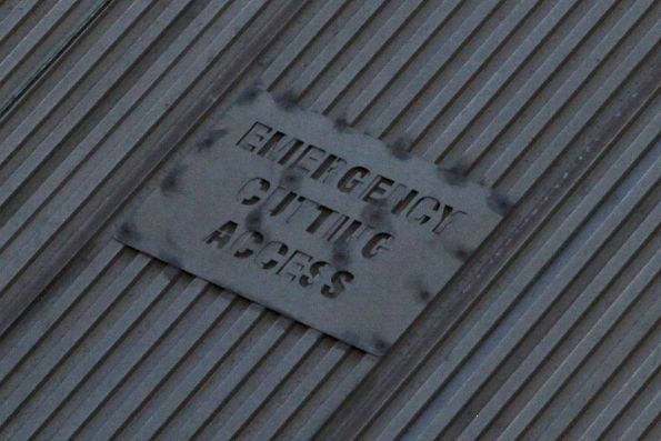 'Emergency Cutting Access' notice on the roof of a IMU train carriage