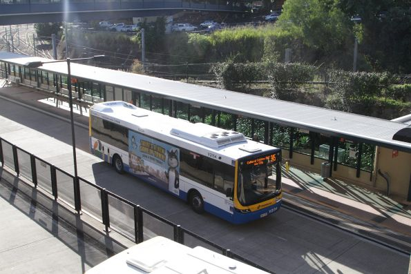 Brisbane Transport bus V2154 on route 345 stops at Normanby station on the Northern Busway