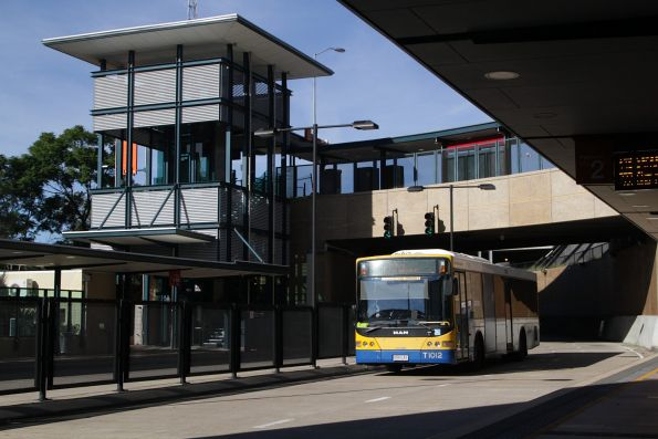 Brisbane Transport bus T1012 heads empty through Normanby station on the Northern Busway